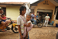 "Dian Dama Yanthi, 32, and her child Gilang Rama, 1, are seen on the outskirts of Jakarta, Indonesia, April 19, 2006. Dian had an unsafe abortion and lost her best friend to an unsafe abortion. Both took the traditional medicine ""jamu."" Dian also had a massage from a traditional birthing attendant. Over two million abortions are performed in Indonesia every year, many by unskilled practitioners. Thousands of women survive but often with life-long disabilities. It is said by doctors and activists that a woman dies every hour in Indonesia due to unsafe abortions."