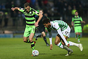 Forest Green Rovers Christian Doidge(9) and Yeovil Town's Omar Sowunmi(17) challenge for the ball during the EFL Sky Bet League 2 match between Yeovil Town and Forest Green Rovers at Huish Park, Yeovil, England on 24 April 2018. Picture by Shane Healey.