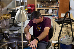 LEXINGTON, Ky., -- Nate Polly owner of Nate's Coffee a small batch coffee roaster removes excess beans from cooling hopper, Monday, Sept. 25, 2017 at the Nate's Coffee in LEXINGTON.