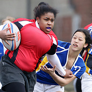 Action from the Rutgers (red) V Hofstra, Women's University  Rugby match during the Four Leaf 15's Club Rugby Tournament at Randall's Island New York. The tournament included 70 teams in 6 divisions, organized by the New York City Village Lions RFC. Randall's Island, New York, USA. 23rd March. Photo Tim Clayton