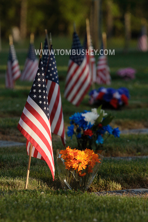 Goshen, New York - Flags and flowers decorate the graves at Orange County Veterans Cemetery on Saturday, May 29, 2010. The flags were placed in the cemetery for Memorial Day.