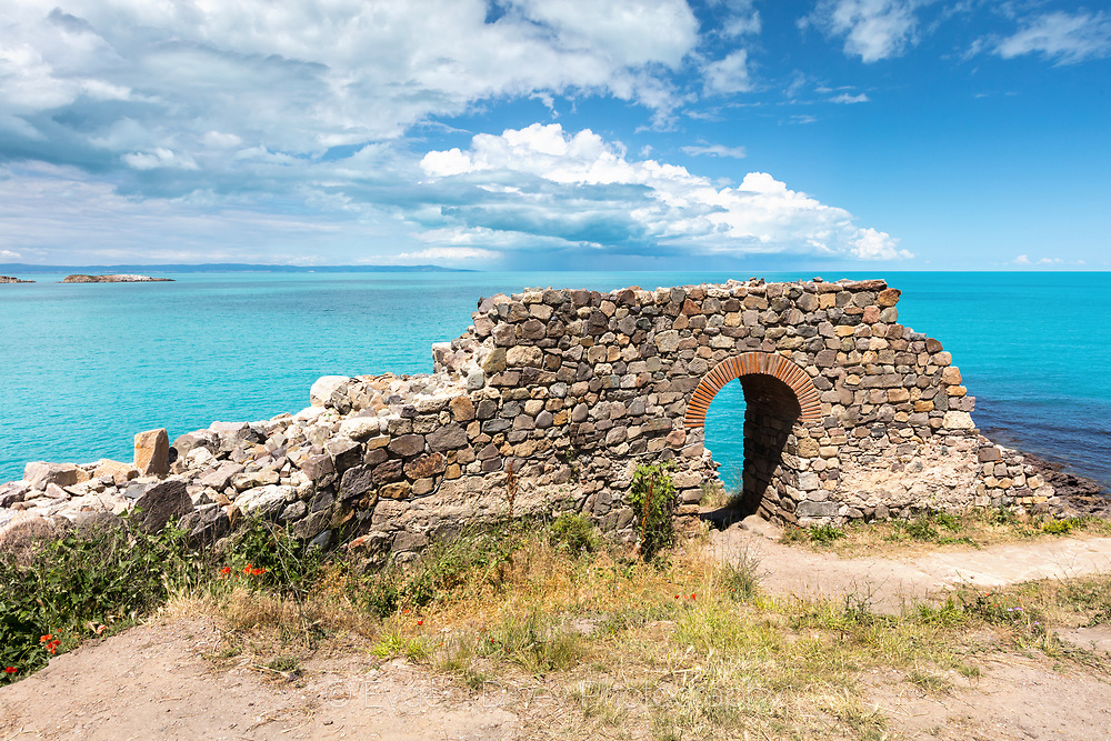 Door in a byzantine fortress by the sea coast