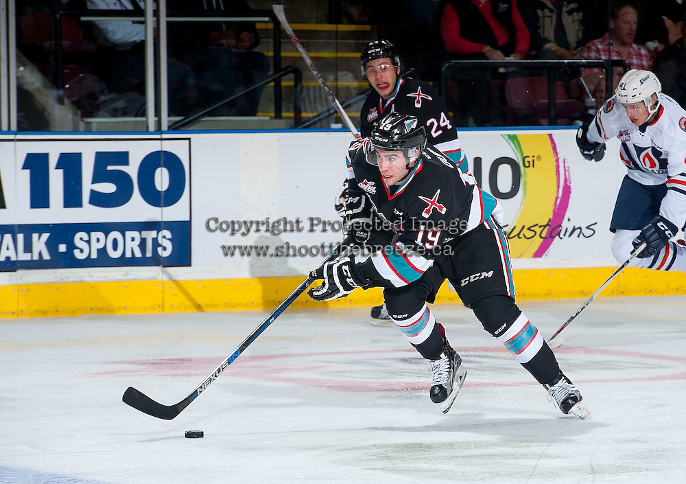 KELOWNA, CANADA - SEPTEMBER 25: Dillon Dube #19 of Kelowna Rockets skates with the puck against the Kamloops Blazers on September 25, 2015 at Prospera Place in Kelowna, British Columbia, Canada.  (Photo by Marissa Baecker/Getty Images)  *** Local Caption *** Dillon Dube;