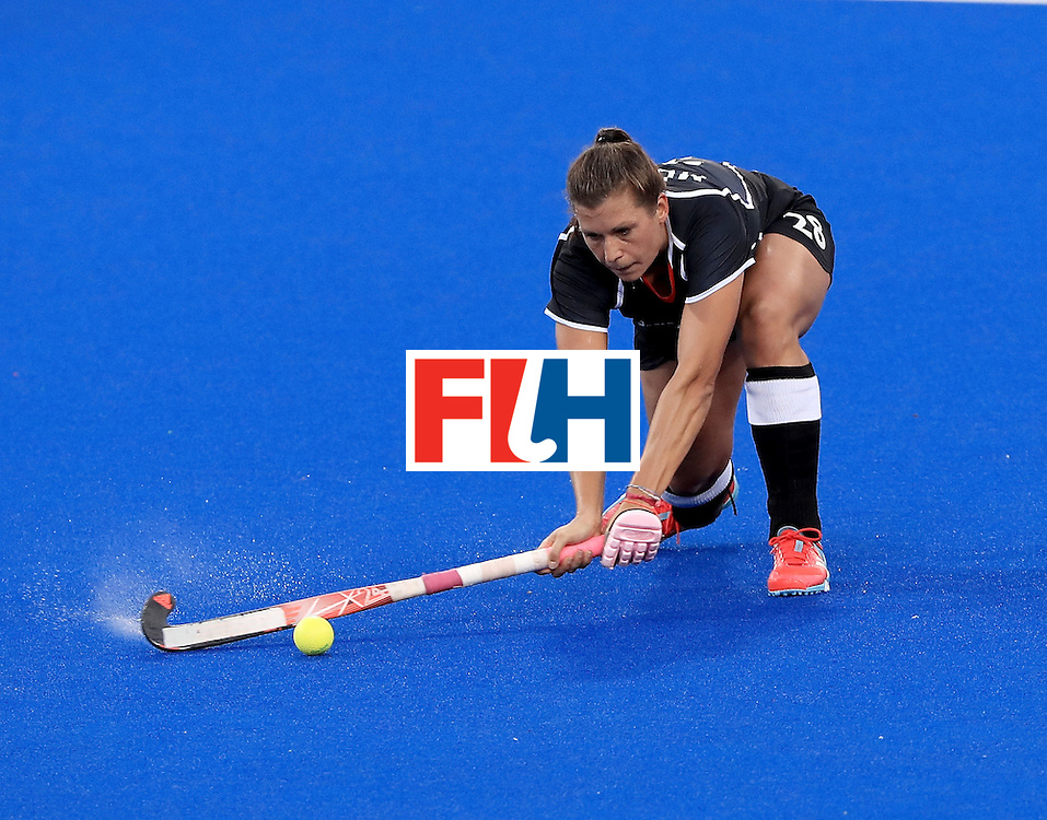 RIO DE JANEIRO, BRAZIL - AUGUST 11:  Julia Muller #8 of Germany makes a pass during a Women's Preliminary Pool A match against Spain at the Olympic Hockey Centre on August 11, 2016 in Rio de Janeiro, Brazil.  (Photo by Sam Greenwood/Getty Images)