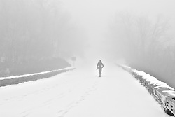Photographer walking in the snow on the Blue Ridge Parkway, North Carolina (NC).