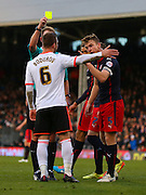 6. Nikolay Bodurov yellow card for handball during the Sky Bet Championship match between Fulham and Reading at Craven Cottage, London, England on 17 January 2015. Photo by Matthew Redman.