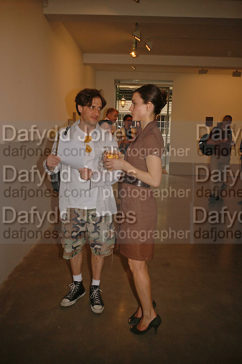 Michael Stumbo and Sybille Gebhardt, Victor  Man , Private view of work by  Victor Man, ' The place I'm coming from'  Timothy Taylor Gallery. London. 4 May 2006. ONE TIME USE ONLY - DO NOT ARCHIVE  © Copyright Photograph by Dafydd Jones 66 Stockwell Park Rd. London SW9 0DA Tel 020 7733 0108 www.dafjones.com