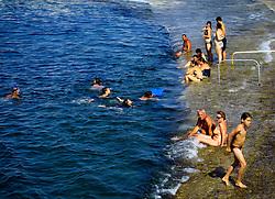 MALTA GOZO MARSALFORN 22JUL06 - Bathers enjoy the blue waters at Ghar Qawqla near Marsalforn...jre/Photo by Jiri Rezac..© Jiri Rezac 2006..Contact: +44 (0) 7050 110 417.Mobile:  +44 (0) 7801 337 683.Office:  +44 (0) 20 8968 9635..Email:   jiri@jirirezac.com.Web:    www.jirirezac.com