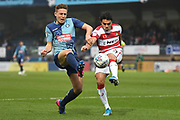 Doncaster Rovers defender Reece James (3) battles for possession  with Wycombe Wanderers midfielder David Wheeler (7) during the EFL Sky Bet League 1 match between Wycombe Wanderers and Doncaster Rovers at Adams Park, High Wycombe, England on 23 November 2019.