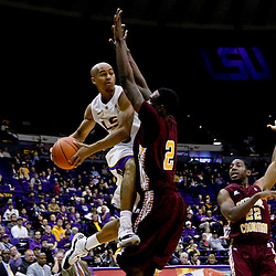 Jan 5, 2013; Baton Rouge, LA, USA; LSU Tigers guard Charles Carmouche (0) looks to pass as Bethune-Cookman Wildcats forward Alex Smith (2) defends during the second half of a game at the Pete Maravich Assembly Center. LSU defeated Bethune-Cookman 79-63. Mandatory Credit: Derick E. Hingle-USA TODAY Sports