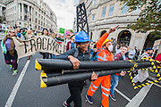 Anti-Fracking protesters target HSBC in global day of action. Mock Drill Rig, 'fracked water', hazard tape and speakers from affected communities turn two Central London HSBCs are turned into 'live fracking sites' in protest about funding to fracking. 'Global Frackdown' day of action sees 100s of actions against fracking in over 30 countries. Trafalgar Square, London. 11 Oct 2014.Guy Bell, 07771 786236, guy@gbphotos.com