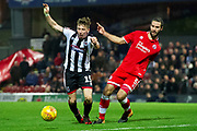 Grimsby Town midfielder Harry Clifton looses his footing and falls to the ground and gets yellow card for diving during the EFL Sky Bet League 2 match between Grimsby Town FC and Crawley Town at Blundell Park, Grimsby, United Kingdom on 17 November 2018.