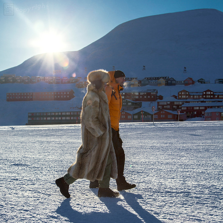 Couple walking on Svalbard, Norway during the 2015 total solar eclipse