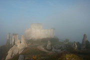 LES ANDELEYS, FRANCE - OCTOBER 10: View of the  embossed ramparts of the Chateau Gaillard in a fog, on October 10, 2008 in Les Andelys, Normandy, France. The chateau was built by Richard the Lionheart in 1196, came under French control in 1204 following a siege in 1203. It was later destroyed by Henry IV in 1603 and classified as Monuments Historiques in 1852. (Photo by Manuel Cohen)