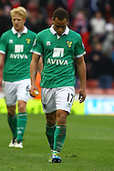 Picture by Paul Chesterton/Focus Images Ltd.  07904 640267.03/03/12.Elliott Bennett of Norwich of Norwich looks despondent at the end of the Barclays Premier League match at the Britannia Stadium, Stoke-on-Trent.