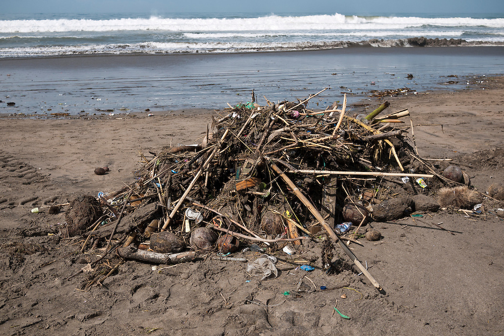 Rubbish collected on Kuta beach awaiting collection, Kuta, Bali, Indonesia.