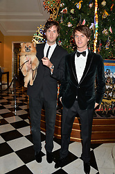 Left to right, brothers ISAAC FERRY and TARA FERRY at the Claridge's Christmas Tree By Dolce & Gabbana Launch Party held at Claridge's, Brook Street, London on 26th November 2013.