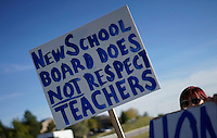 A protestor holds up a sign referring to a controversy with the local school board in Broomfield, Colorado October 3, 2014. The question of how U.S. teens learn history in public schools is the latest flash point in a liberal-conservative fight over national curricula that had previously focused on more scientific topics such as teaching creationism versus evolution.  REUTERS/Rick Wilking (UNITED STATES)