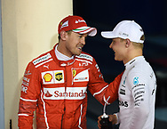 Valtteri Bottas of Mercedes AMG Petronas, with Sebastian Vettel of Scuderia Ferrari, after winning his maiden pole position during the Bahrain Formula One Grand Prix Qualifying session at the International Circuit, Sakhir<br /> Picture by EXPA Pictures/Focus Images Ltd 07814482222<br /> 15/04/2017<br /> *** UK &amp; IRELAND ONLY ***<br /> <br /> EXPA-EIB-170415-0334.jpg
