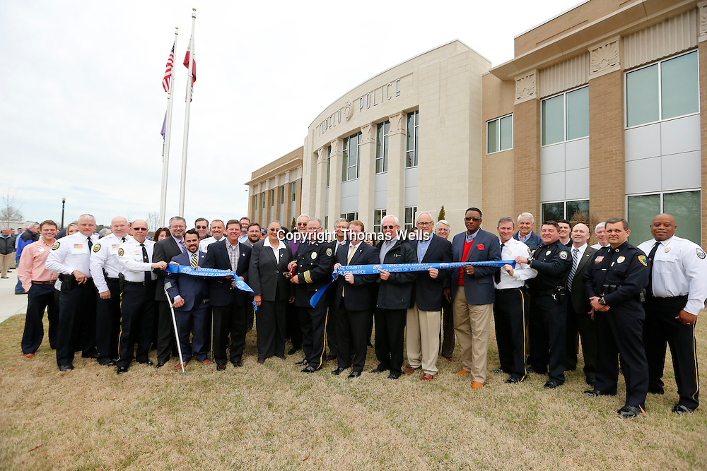 THOMAS WELLS | BUY at PHOTOS.DJOURNAL.COM<br /> City offcials cut the ribbon to to close Monday's grand opening ceremony for the City of Tupelo's new Police Department Headquarters on Front Street.