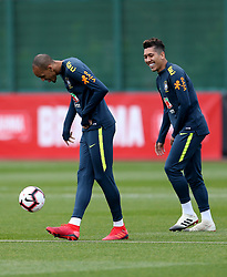 Brazil's Fabinho (left) and Roberto Firmino during the training session at London Colney, Hertfordshire.
