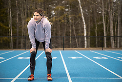 Kate Hall trains alone on the track shortly after the country's pandemic stay-at-home response went into effect