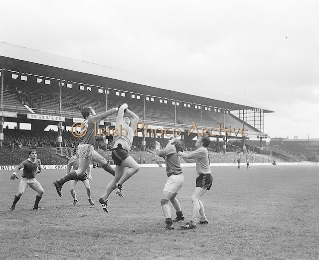 Two players jump high to go for the ball during the Antrim v Mayo All Ireland Minor Gaelic Football Final in Croke Park on the 8th of September 1974.