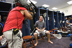 28 May 2007: Duke Blue Devils attackman Max Quinzani (16) with a ESPN TV camera pregame in the locker room before playing Johns Hopkins in the NCAA Championship at M&T Stadium in Baltimore, MD.