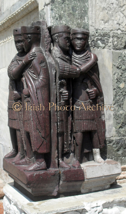 The Portrait of the Four Tetrarchs (A group of four Roman emperors), on the facade of San Marco in Venice, Italy. The Roman Empire was for a time after 293 ruled by a tetrarchy (a group of four rulers), instituted by Emperor Diocletian. The tetrarchy consisted of two Augusti (senior emperors) and two Caesars (younger emperors). The empire was territorially divided into western and eastern halves, with a senior and a junior emperor in each half. After Diocletian and his colleague, Maximian, retired in 305, internal strife erupted among the tetrarchs. The system finally ceased to exist around 313.