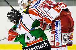17.02.2015, Hala Tivoli, Ljubljana, SLO, EBEL, HDD Telemach Olimpija Ljubljana vs EC KAC, 4. Qualification Round, in picture Igor Cvetek (HDD Telemach Olimpija, #4) vs Patrick Harand (EC KAC, #16) during the Erste Bank Icehockey League 4. Qualification Round between HDD Telemach Olimpija Ljubljana and EC KAC at the Hala Tivoli, Ljubljana, Slovenia on 2015/02/17. Photo by Morgan Kristan / Sportida