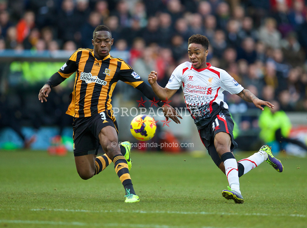 HULL, ENGLAND - Sunday, December 1, 2013: Liverpool's Raheem Sterling in action against Hull City's Maynor Figueroa during the Premiership match at the KC Stadium. (Pic by David Rawcliffe/Propaganda)