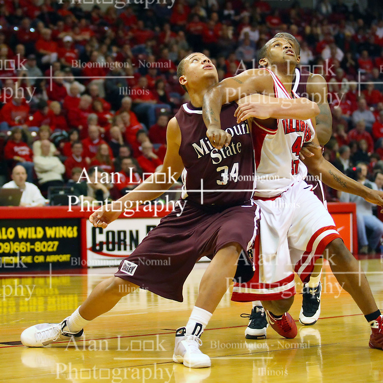 18 January 2009: Kyle Weems and Brandon Sampay get locked up, each trying to keep the other from a rebound after a foul shot. The Illinois State University Redbirds top the Missouri State Bears 68-56 on Doug Collins Court inside Redbird Arena on the campus of Illinois State University in Normal Illinois