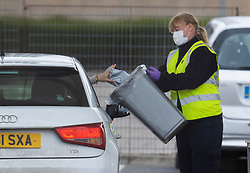 © Licensed to London News Pictures. 01/04/2020. London, UK. A visitor drops a sample into a collecting bin at a new coronavirus testing centre which has opened in the car park of the O2 Arena on the Greenwich Peninsula in London. Death rates from the spread of coronavirus continue to climb. Photo credit: Peter Macdiarmid/LNP