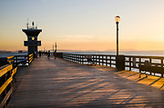 People Walking on the Seal Beach Pier at Sunset