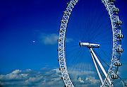 Airplane flying into the London Eye above the clouds, London, England