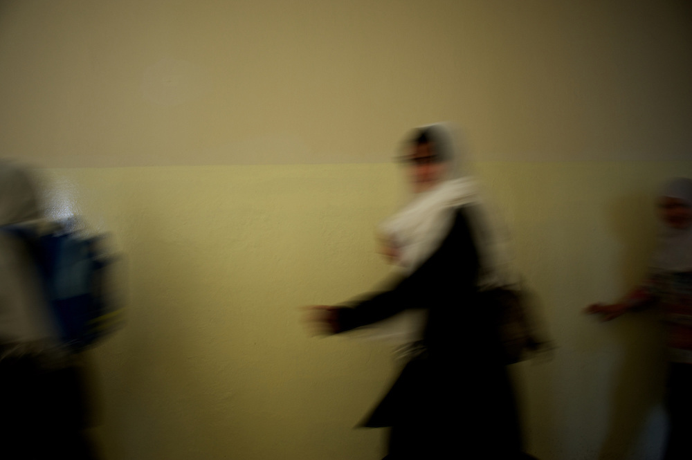 November 11, 2012 - Kabul, Afghanistan: Female students pass by on their way to a class at Shirino High School in Kabul...After decades without access to education under the Taliban regime, and despite the still existent social stigmas, female students make now 40 per cent of the over all students in the country. (Paulo Nunes dos Santos)