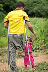16 November 2018, San José de León, Mutatá, Antioquia, Colombia: 48-year-old Ivan greets one of the community's little ones. Ivan walks on crutches as he is missing a leg. He lived 31 years as a FARC guerilla combatant, before settling in San José de León after the 2016 peace treaty in Colombia. Following the 2016 peace treaty between FARC and the Colombian government, a group of ex-combatant families have purchased and now cultivate 36 hectares of land in the territory of San José de León, municipality of Mutatá in Antioquia, Colombia. A group of 27 families first purchased the lot of land in San José de León, moving in from nearby Córdoba to settle alongside the 50-or-so families of farmers already living in the area. Today, 50 ex-combatant families live in the emerging community, which hosts a small restaurant, various committees for community organization and development, and which cultivates the land through agriculture, poultry and fish farming. Though the community has come a long way, many challenges remain on the way towards peace and reconciliation. The two-year-old community, which does not yet have a name of its own, is located in the territory of San José de León in Urabá, northwest Colombia, a strategically important corridor for trade into Central America, with resulting drug trafficking and arms trade still keeping armed groups active in the area. Many ex-combatants face trauma and insecurity, and a lack of fulfilment by the Colombian government in transition of land ownership to FARC members makes the situation delicate. Through the project De la Guerra a la Paz ('From War to Peace'), the Evangelical Lutheran Church of Colombia accompanies three communities in the Antioquia region, offering support both to ex-combatants and to the communities they now live alongside, as they reintegrate into society. Supporting a total of more than 300 families, the project seeks to alleviate the risk of re-victimization, or relapse into violent co