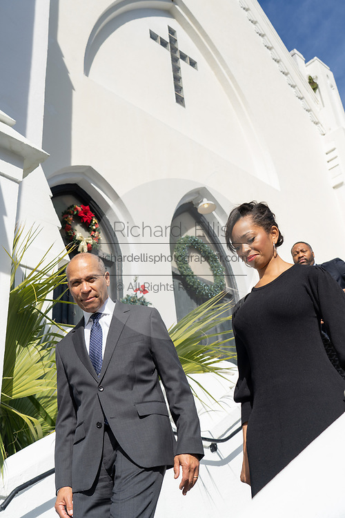 Democratic presidential hopeful Gov. Deval Patrick, left, walks with state campaign director LaJoia Broughton as they depart the historic Mother Emanuel AME Church following Sunday service January 1, 2020 in Charleston, South Carolina. The service celebrated Emancipation Day, marking the abolition of slavery in the United States.