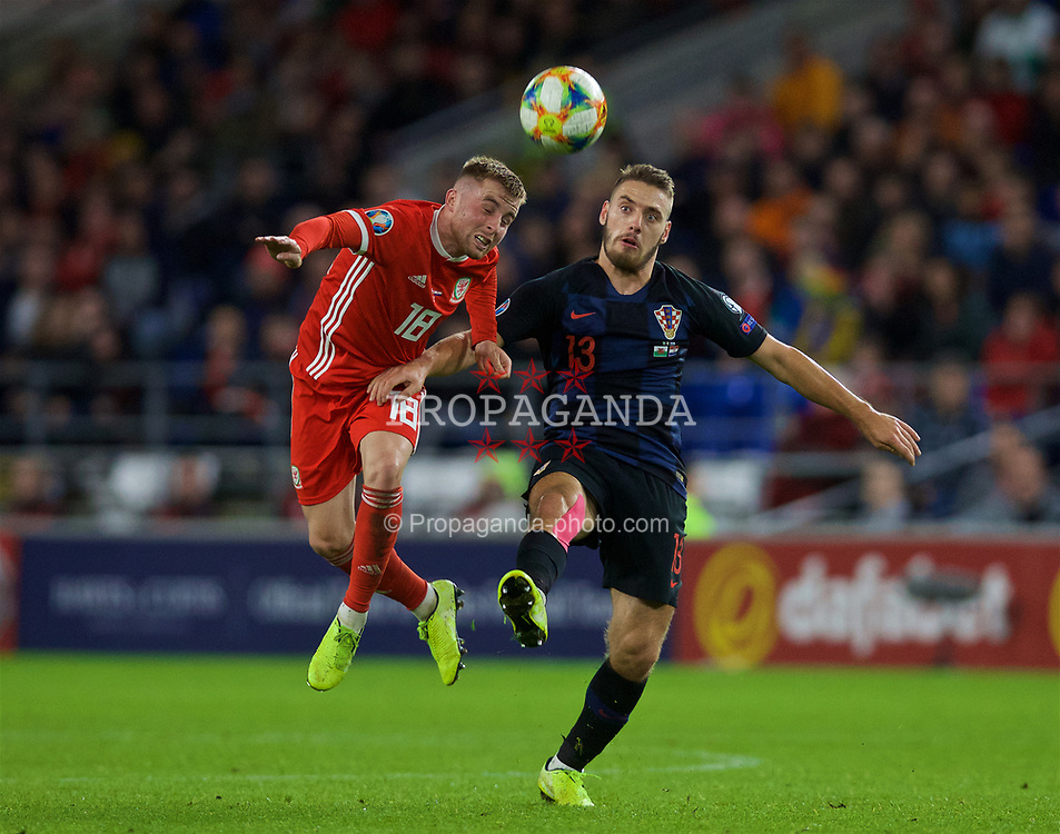 CARDIFF, WALES - Sunday, October 13, 2019: Wales' Joe Morrell (L) and Croatia's Nikola Vlašić during the UEFA Euro 2020 Qualifying Group E match between Wales and Croatia at the Cardiff City Stadium. (Pic by Laura Malkin/Propaganda)