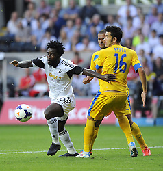 "Swansea City's Wilfried Bony battles for the ball with Petrolul Ploiesti's Alexandru Benga  - Photo mandatory by-line: Joe Meredith/JMP - Tel: Mobile: 07966 386802 22/08/2013 - SPORT - FOOTBALL - Liberty Stadium - Swansea -  Swansea City V Petrolul Ploiesti - Europa League Play-Off EDITORIAL USE ONLY. No use with unauthorised audio, video, data, fixture lists, club/league logos or ""live"" services. Online in-match use limited to 45 images, no video emulation. No use in betting, games or single club/league/player publications"