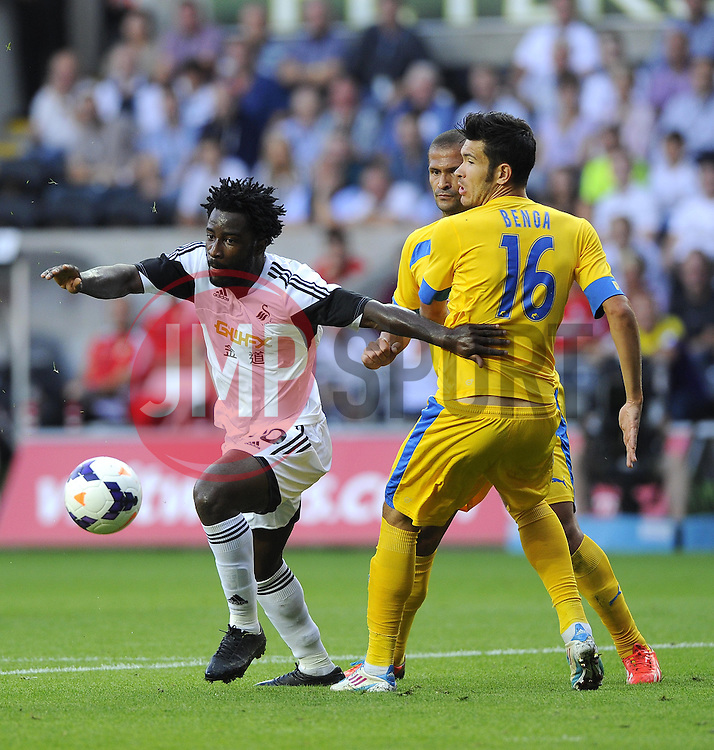 """Swansea City's Wilfried Bony battles for the ball with Petrolul Ploiesti's Alexandru Benga  - Photo mandatory by-line: Joe Meredith/JMP - Tel: Mobile: 07966 386802 22/08/2013 - SPORT - FOOTBALL - Liberty Stadium - Swansea -  Swansea City V Petrolul Ploiesti - Europa League Play-Off EDITORIAL USE ONLY. No use with unauthorised audio, video, data, fixture lists, club/league logos or """"live"""" services. Online in-match use limited to 45 images, no video emulation. No use in betting, games or single club/league/player publications"""