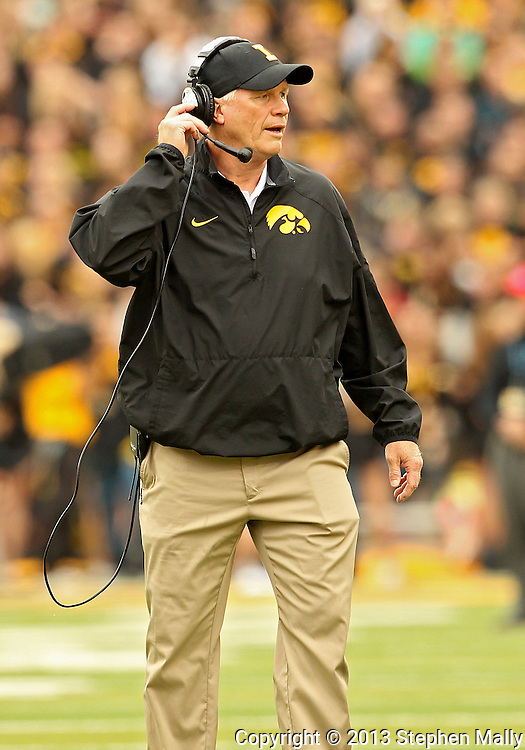 October 6 2013: Iowa Hawkeyes Defensive Line coach Reese Morgan during the first quarter of the NCAA football game between the Michigan State Spartans and the Iowa Hawkeyes at Kinnick Stadium in Iowa City, Iowa on October 6, 2013. Michigan State defeated Iowa 26-14.