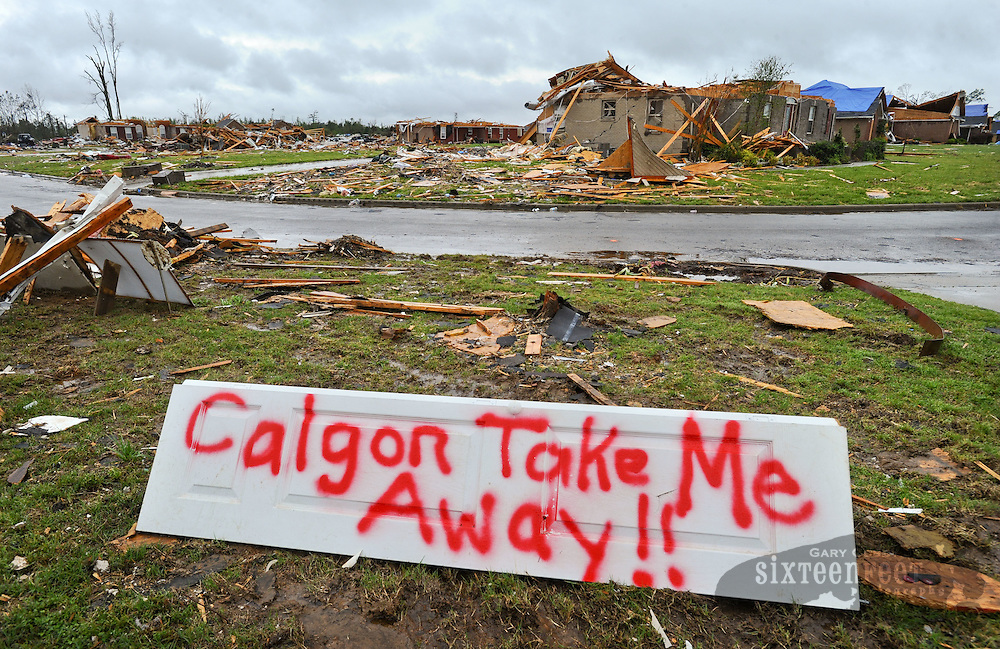Daily Photo by Gary Cosby Jr...Residents of Camden Ct. near McCulley Mill Rd. in eastern Limestone County used humor to help deal with the storm damage.  Many residents left humorous signs painted on the remains of their homes.\