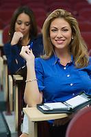 Business women sitting in auditorium