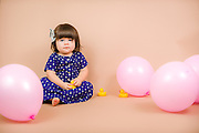 Toddler with balloons