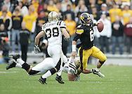 17 NOVEMBER 2007: Iowa quarterback Jake Christensen (6) is tripped up by Western Michigan defensive end Zach Davidson (90) in Western Michigan's 28-19 win over Iowa at Kinnick Stadium in Iowa City, Iowa on November 17, 2007.