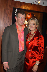 JO MALONE and her husband GARY WILLCOX at a party hosted by Jo Malone - Pomegranate Noir, held at The Vinyl Factory, 45 Foubert's Place, London W1 on 15th September 2005.<br />