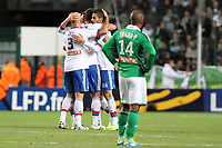 FOOTBALL - FRENCH LEAGUE CUP 2011/2012 - 1/8 FINAL - AS SAINT ETIENNE v OLYMPIQUE LYONNAIS - 26/10/2011 - PHOTO EDDY LEMAISTRE / DPPI - JOY OF LYON TEAM CRIS, MAXIME GONALONS (OL) AND DESPITE OF FLORENT SINAMA PONGOLLE (ASSE)