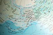 North America map on a globe focused on Alaska and Bering Sea