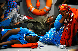 Would-be immigrants rest on the deck of an Armed Forces of Malta (AFM) patrol boat after arriving at the AFM Maritime Squadron base at Haywharf in Valletta's Marsamxett Harbour early July 10, 2013. Sixty-eight African immigrants were rescued by the AFM, 70 nautical miles south of Malta, from a vessel in distress while trying to reach European soil from Africa, according to army sources. <br />